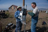 Volunteers installing Weather Station at Hydro Plant -